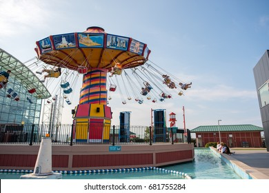 CHICAGO, IL, July 19, 2017: People ride the Pepsi Wave Swinger, a famous carnival ride at Navy Pier, which attracts more than nine million visitors each year.