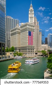 Chicago, IL - July 3, 2014: To celebrate America's Independence Day, a nine-story tall American flag hangs from the Wrigley Building in downtown Chicago, Illinois. (2435)