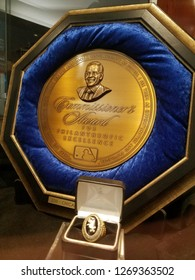 Chicago, IL July 30, 2018, Chicago White Sox 2011 Commissioner's Award for Philanthropic Excellence on display, gold and blue trophy, Major League Baseball