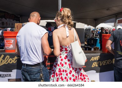 CHICAGO, IL June 24, 2017: Beautiful woman with retro, vintage, 1950's style clothing is perfectly dressed for a Rockabilly-themed street fest. Chicago hosts dozens of outdoor street fests each summer