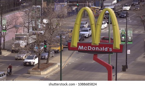 CHICAGO, IL - MARCH 19: Mcdonald's sign along downtown intersection with morning traffic in Chicago, Illinois on March 19, 2018.