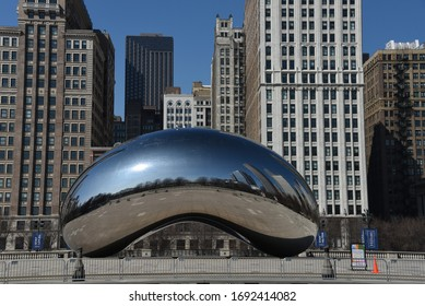 Chicago, IL March 25, 2020, Cloud Gate the Bean in Millennium Park under a clear blue sky with the Chicago Skyline in the background