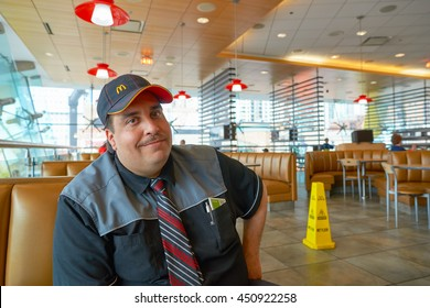 CHICAGO, IL -  MARCH 31, 2016: inside portrait of the worker in the Rock N Roll McDonald's. The Original Rock N Roll McDonald's is a flagship McDonald's restaurant located in Chicago, Illinois