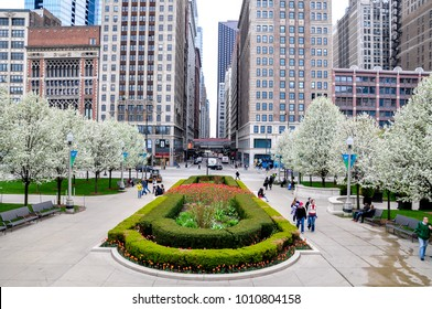 CHICAGO, IL - MAY 5, 2011 - View of Madison St. intersection with Michigan Ave, next to Millenium Park, during spring, with trees in full blossom