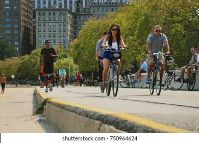 CHICAGO, IL - SEPTEMBER 16, 2012: Bicyclists ride along the Chicago Lakefront Trail, an 18-mile long shared use path along Lake Michigan for pedestrians, bicyclists, recreationalists, and commuters.