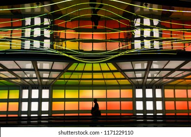 """Chicago, IL - September 2, 2018: The colorful neon tunnel """"The Sky is the Limit"""" at Chicago's O'Hare International Airport (ORD) connecting the B and C concourses. (9859)"""