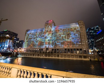 Chicago, IL - September 29th, 2018: Colorful art lights up the facade of Merchandise Mart after the grand opening of Art on theMart, the longest running digital art display in the world in downtown.