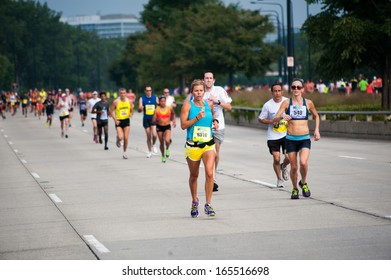 CHICAGO, IL - SEPTEMBER 8: Participants in the Chicago Half Marathon run down South Lake Shore Drive on September 8, 2013 in Chicago, Illinois.
