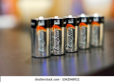 Chicago, IL, United States; February 16, 2018: Shot of five type C batteries manufactured by Energizer on a table with a blurred background and foreground.