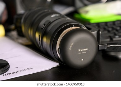 Chicago, IL, United States - May 7, 2019: Tamron's 70-200mm f2.8 G2 lens having a firmware update through the Tamron Tap-In Console.