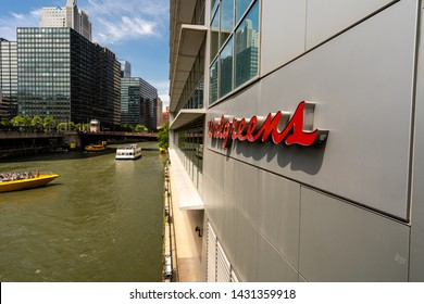 Chicago, IL / US - June 22 2019: Walgreens sign located on the Chicago River with several boats passing by