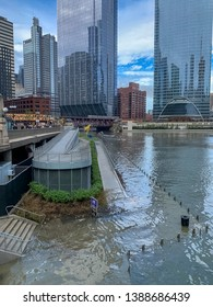 Chicago, IL / USA - 5/1/19: Riverwalk is submerged with floodwaters of the Chicago River after major rainstorm