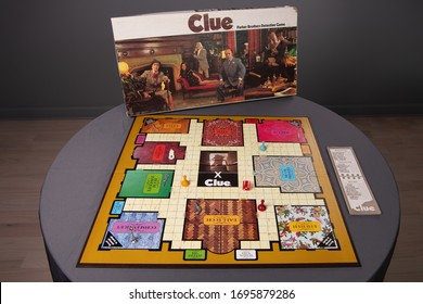 Chicago, IL / USA - April 5, 2020: View of the whole board of a vintage, antique Clue Game with the box behind. Illustrative Editorial.