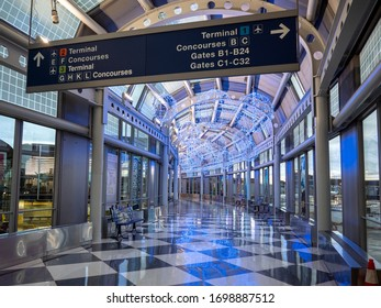 Chicago, IL / USA - April 8 2020: Empty halls at O'Hare International Airport during the coronavirus pandemic and stay-at-home orders for most states