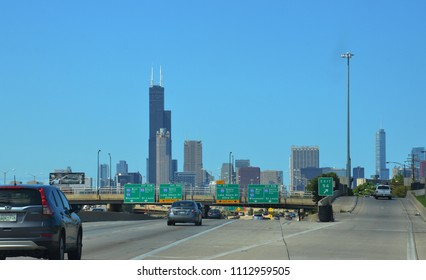 CHICAGO, IL / USA - AUGUST 12, 2017: Cars travel on highway into downtown Chicago