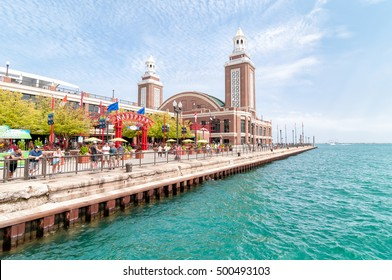 Chicago, IL, USA - August 24, 2014: Tourists enjoy a summer day at famous Navy Pier garden. Its a favorite tourist destination with many parks, gardens, shops, restaurants and other entertainments.