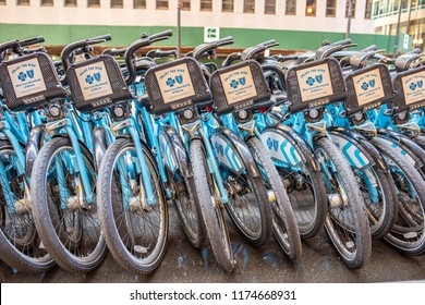 Chicago, IL / USA - August 30, 2018: A row of Divvy bicycles ready to be ridden, downtown Chicago. Divvy is a famous and popular ride share option in the city.