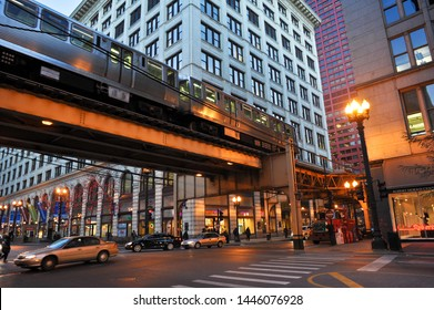 CHICAGO, IL / USA - DECEMBER 8 2010: A brown line train rides on the elevated tracks over E Van Buren at S State Street, past DePaul University DePaul Center and the Robert Morris Center.