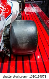 Chicago, IL, USA - February 10, 2019: Rear right tire of Alfa Romeo Sauber Formula 1 race car on display at the 2019 Chicago Auto Show.