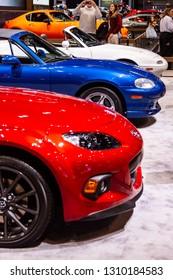 Chicago, IL, USA - February 10, 2019: Shot of all three generations of Mazda Miatas at the 2019 Chicago Auto Show.