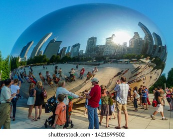 Chicago, IL, USA - July 22 2011: Cloud Gate is a public sculpture by Anish Kapoor, in Millenium Park. Its highly reflective, curved surface distorts the refelctions of  people & buildings