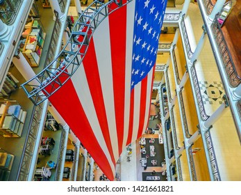 Chicago, IL, USA - June 27 2009: A giant US flag hangs in the atrium of Marshall Field & Company, at one stage the largest department store in the world.