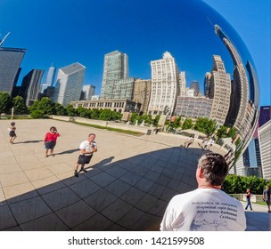 Chicago, IL, USA - June 28 2009: Cloud Gate is a public sculpture by Anish Kapoor, in Millenium Park. Its highly reflective, curved surface distorts the refelctions of  people & buildings