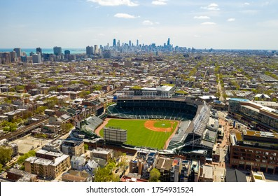 Chicago, IL / USA - June 6, 2019: Aerial View of Wrigley Field with Chicago Skyline in Background
