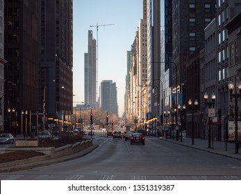 Chicago, IL / USA - March 23 2019: Construction crane on the Near South Side seen from N Michigan Ave & Wacker Dr on an early morning. The new skyscraper is changing the city skyline