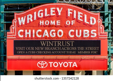 CHICAGO, IL, USA - MARCH 25, 2019: Major League Baseball's Chicago Cubs' Wrigley Field stadium sign with a sponsor message from Wintrust Bank on the marquee.