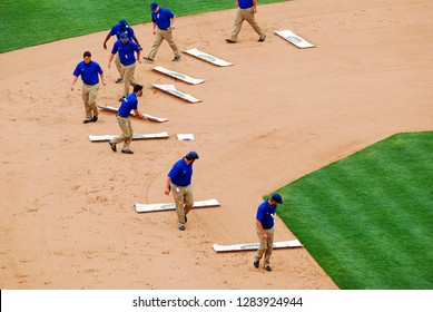 Chicago, IL, USA Mat 29, 2012 The grounds crew tidies up the infield at Chicago's Wrigley Field