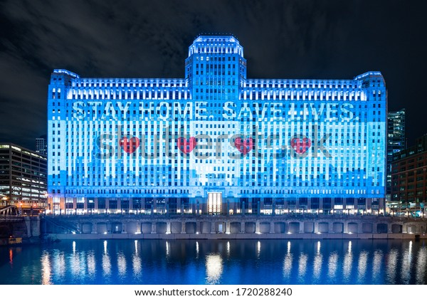 Chicago, IL / USA - May 01 2020: Merchandise Mart Lights Up for Coronavirus during COVID-19 Pandemic