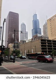 CHICAGO, IL, USA - MAY 27 2013: 2013: Cars and a bus drive through the intersection of Dearborn St and  Ida Wells Dr. The Willis Tower is in the center and the city jail on the right.