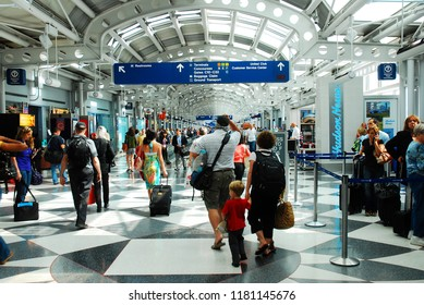 Chicago, IL, USA May 28, 2012 Travelers make their way through a maze of corridors in Chicago's O'Hare International Airport