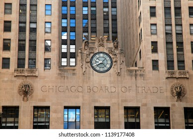 Chicago, IL, USA May 29, 2012 A closeup of Board of Trade Building along LaSalle Street in Chicago, Illinois with a clock, two clerks and an eagle sculpture
