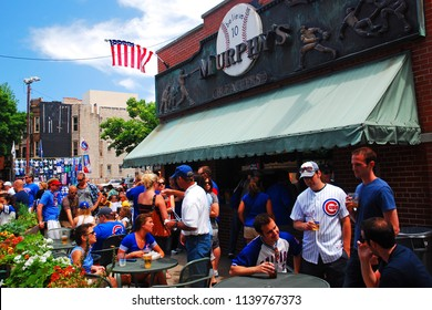 Chicago, IL, USA May 29, 2012 Fans celebrate a Cubs win at Murphy's, a tavern outside of Wrigley Field in Chicago
