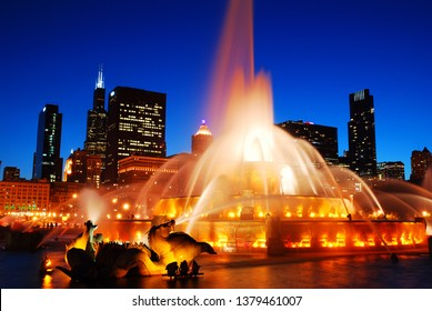 Chicago, IL, USA May 29, 2012 The waters of the Buckingham Fountain in Chicago are illuminated against the city's skyline