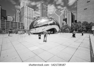 "CHICAGO, IL, USA - MAY 29, 2019: Cloud Gate, nicknamed ""Bean,"" is located on Michigan Avenue within the cities Millennium Park, which features art, music, and theater to the public. Black and white."