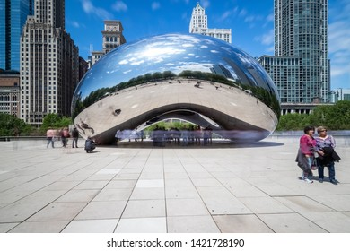 "CHICAGO, IL, USA - MAY 29, 2019: Cloud Gate, nicknamed ""Bean,"" is located on Michigan Avenue within the cities Millennium Park, which features art, music, and theater to the public."