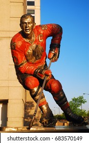 Chicago, IL, USA May 29, 2012 Hockey great Stan Mikita is honored by the Chicago Blackhawks with a statue outside of the United Center in Chicago, Illinois