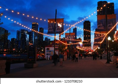 Chicago, IL, USA May 30, 2012 Lights strung over the pedestrian way illuminates a dusk scene in Navy Pier in Chicago