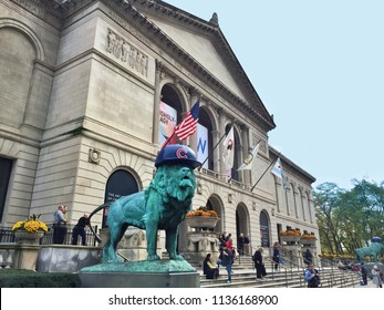 Chicago, IL, USA, October 2016: exterior of the Chicago Art Institute with the bronze lion statue dressed with a Chicago Cubs hat