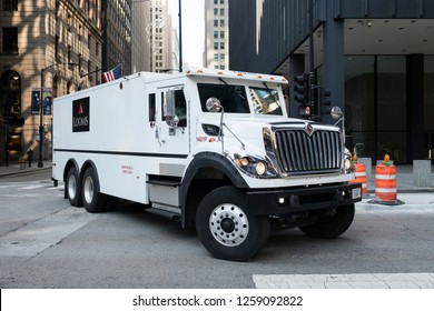 Chicago, IL - USA - OCTOBER 9, 2018: Loomis armored money truck in Chicago, USA. Loomis is a cash handling company operating 3,000 money vehicles in the US. - Image