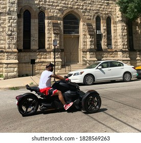 Chicago, Il USA - October 6, 2020. A man driving a Ryker on a Chicago street.