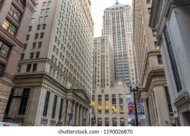 Chicago, IL / USA - September 20, 2017: The famous, iconic Chicago Board of Trade (CBOT) rises in the distance, at the end of the street, downtown Chicago, in the Loop.