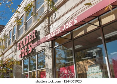 CHICAGO, IL, US-OCT 17, 2018: Close-up logo of Trader Joes's supermarket storefront in downtown Chicago. An American privately held chain of specialty grocery stores, discount retailer, own by ALDI