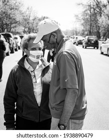CHICAGO, ILL. USA MAY 16, 2020: CHICAGO MAYOR LORI LIGHTFOOT AND 17th WARD ALDERMAN DAVID MOORE HAVING A DISCUSSION DURING A DRIVE THRU GIVEAWAY ON THE CITY SOUTH SIDE DURING THE HEIGHT OF COVID 19