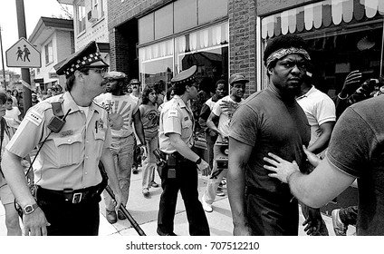 Chicago, Illinois, 28Th June, 1986 Chicago police escort a group of black protestors along 71st in the Marquette Park area during a planned KKK rally.