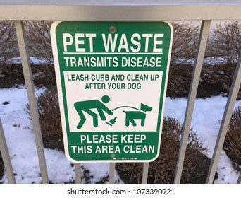 CHICAGO, ILLINOIS - APRIL 20, 2018: sign instructs dog walkers to leash curb and clean up after dogs near west side off Green street.