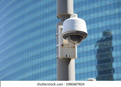 CHICAGO, ILLINOIS - APRIL 30, 2018: CCTV CPD police security camera with facial recognition monitors CTA and CDOT bridge walkway near Wacker and Lake Streets.